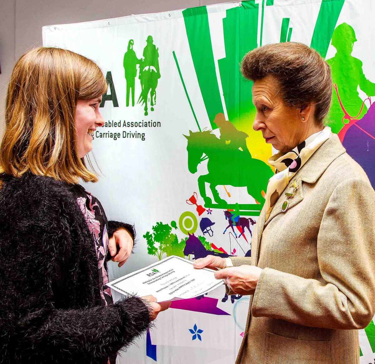 Presented with athe RDA Gold Equestrian Medal by the Princess Royal