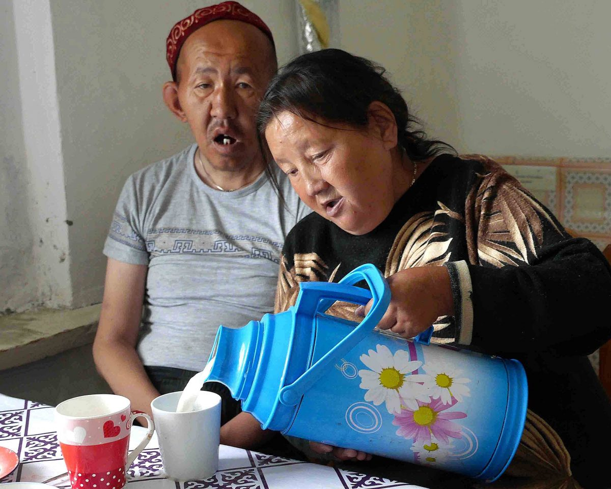 Oral pouring tea for her brother