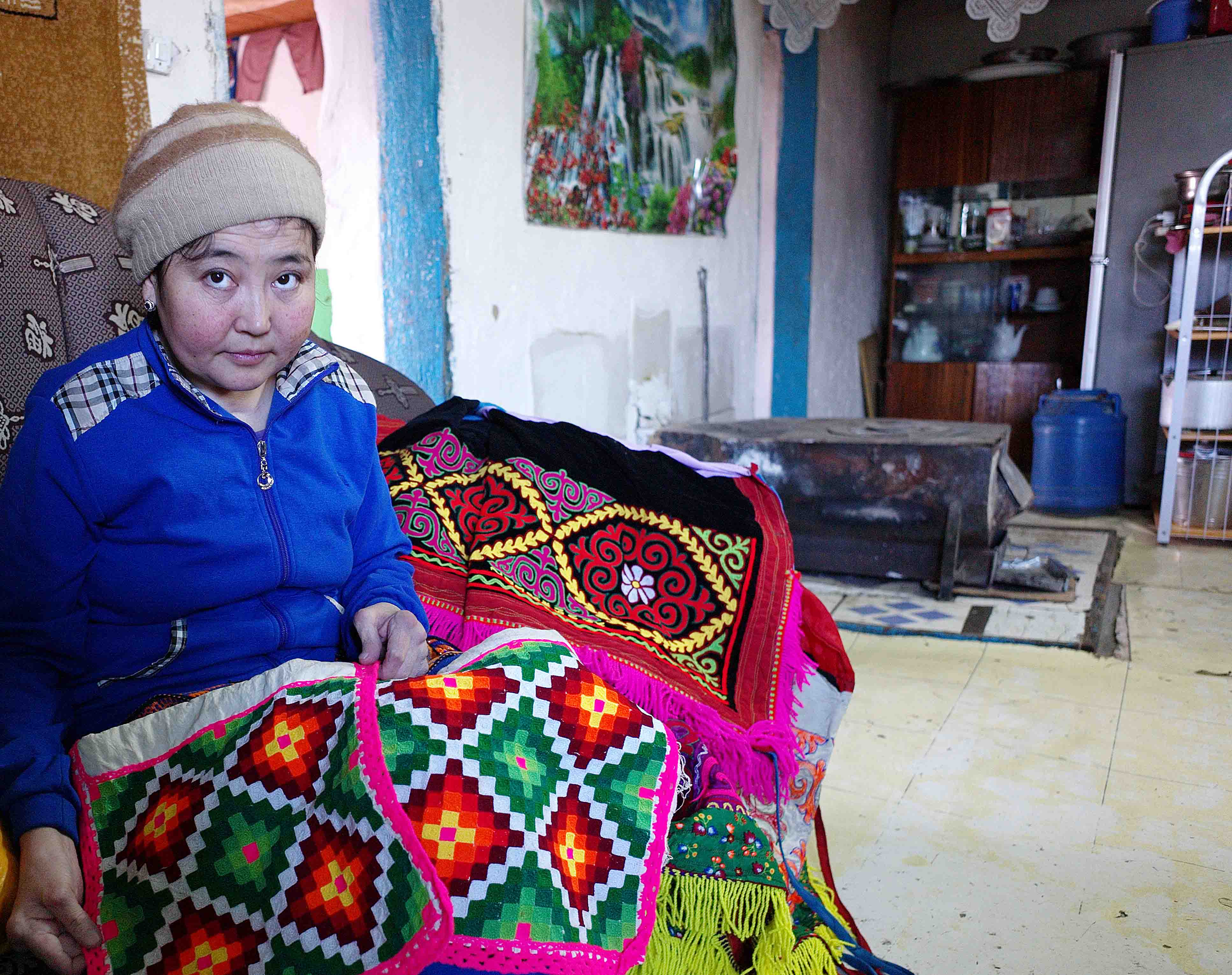 Lena showing her traditional Kazakh needlework skills. She is unable to undertake such work now due to her rheumatoid arthritis.
